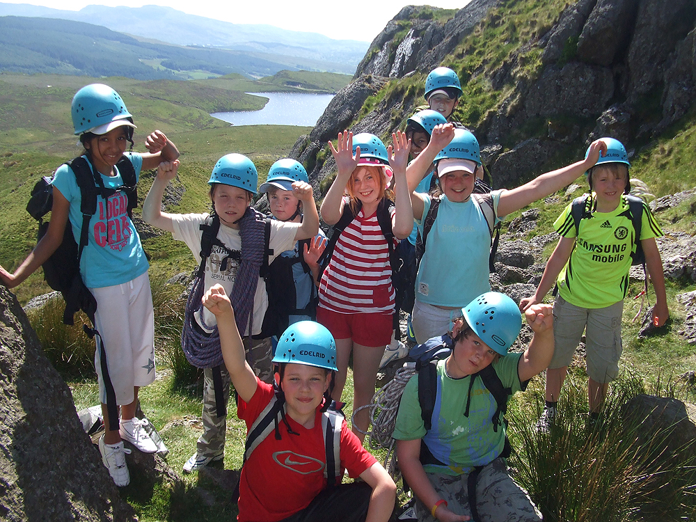 School group preparing to rock climb